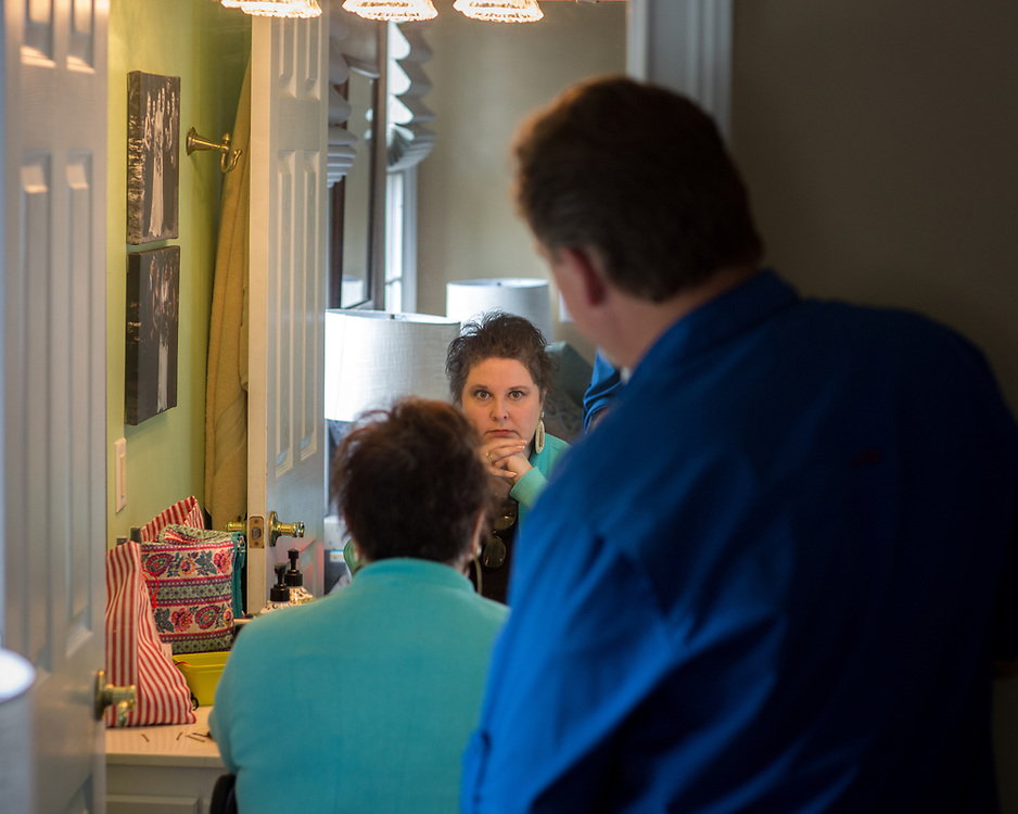 BLACKSHEAR, GA - MARCH 25, 2021: Coming to terms with her illness and its effects is made easier with the love of her devoted husband Jeff Martin. He complements Lisa's natural hair as she changes wigs in the bathroom of the home. (AJC Photo/Stephen B. Morton)