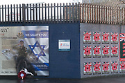 Belfast Peace Wall. Shankhill Unionist side. With pro British and pro Israeli murals. The peace lines or peace walls are a series of separation barriers in Northern Ireland that separate predominantly Republican and Nationalist Catholic neighbourhoods from predominantly Loyalist and Unionist Protestant neighbourhoods. They have been built at urban interface areas in Belfast, Derry, Portadown and elsewhere. The stated purpose of the peace lines is to minimise inter-communal violence between Catholics of whom are nationalists who self-identify as Irish) and Protestants of whom are unionists who self-identify as British).