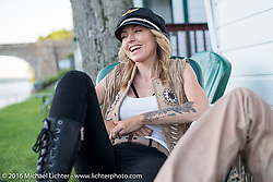 Iron Lilly Leticia Cline after a ride during Laconia Motorcycle Week 2016. NH, USA. Sunday, June 19, 2016.  Photography ©2016 Michael Lichter.