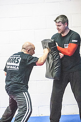 Students practising their punches with the pads. Stef Noij, KMG Instructor from the Institute Krav Maga Netherlands, takes the IKMS G Level Programme seminar today at the Scottish Martial Arts Centre, Alloa.