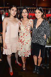 Left to right, MADDIE MILLS, YASMIN MILLS and LAURIE MILLS at the launch of Giovanni's Gin Joint at Quaglino's, 16 Bury Street, London on 13th July 2016.