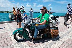 Panhead Fred (Stephen Keith) riding his 1948 Indian Chief in the Cross Country Chase motorcycle endurance run from Sault Sainte Marie, MI to Key West, FL. (for vintage bikes from 1930-1948). The Grand Finish in Key West's Mallory Square after the 110 mile Stage-10 ride from Miami to Key West, FL and after covering 2,368 miles of the Cross Country Chase. Sunday, September 15, 2019. Photography ©2019 Michael Lichter.