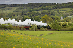© Licensed to London News Pictures. 20/05/2021. Shere, UK. The world famous LNER Flying Scotsman steam locomotive passes through the Surrey Hills near Shere in the south east. The heritage steam locomotive touring season was mostly cancelled last year due to the Covid-19 pandemic but is now underway as restrictions are eased. Built in 1923 for the London and North Eastern Railway (LNER) it was run on the London to Edinburgh Flying Scotsman train service after which it was named. It was the first steam loco to reach 100 miles per hour in 1934. Photo credit: Peter Macdiarmid/LNP