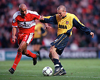 Fredrik Ljungberg (Arsenal) shots as Curtis Fleming (Middlesbrough) closes in. Middlesbrough 0:1 Arsenal. F.A.Carling Premiership, 4/11/2000. Credit: Colorsport / Stuart MacFarlane.