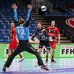 Handball, 31. Spieltag: MT Melsungen vs Die Eulen Ludwigshafen am 27.05.2021 in der Rothenbach-Halle in Kassel<br /> <br /> <br /> Alexander Falk (Ludwigshafen 20) gegen Torwart Silvio Heinevetter (Melsungen 12)     beim Spiel in der Handball Bundesliga, MT Melsungen - Die Eulen Ludwigshafen.<br /> <br /> Foto © PIX-Sportfotos *** Foto ist honorarpflichtig! *** Auf Anfrage in hoeherer Qualitaet/Aufloesung. Belegexemplar erbeten. Veroeffentlichung ausschliesslich fuer journalistisch-publizistische Zwecke. For editorial use only.