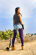 Trendy hip woman with purple tights outdoors