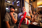 Andrew Pipis nervously clutches the American flag as he watches the World Cup soccer match between England and the USA from Conor O'Neill's Pub in Boulder, Colorado. The match ended in a 1-1 tie.
