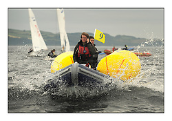 470 Class European Championships Largs - Day 1.Racing in grey and variable conditions on the Clyde..Mark boat with Alistair Leicester