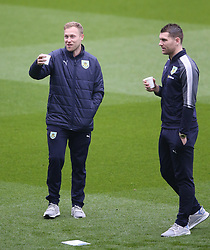 Burnley's Scott Arfield (left) Sam Vokes inspect the pitch