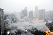 XI\'AN, CHINA - NOVEMBER 15: (CHINA OUT) <br /> <br /> 118-meter-tall Building Blasts Down<br /> <br /> Smokes rise from the blast site of the 118-meter-tall building on November 15, 2015 in Xi\'an, Shaanxi Province of China. The successful explosion of the 118-meter-tall building on Sunday morning in Xi'an made the blast record of the tallest building in China.<br /> ©Exclusivepix Media