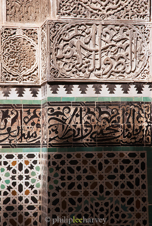 Patterned and carved wall at Place Nejjarine outside the Nejjarine Museum in the medina of Fes, Morocco