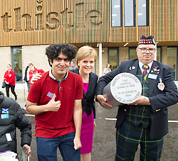 Pictured: Rameez, who will return in 2044 to dig up the capsule, Nicola Sturgeon and one of the 'men in sheds'<br /> <br /> The First Minister Nicola Sturgeon, MSP, joined people supported by the Thistle Foundation to bury a time capsule to mark the opening of a new health and social care centre. <br /> Ger Harley | EEm 14 June 2016