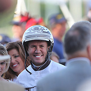 Driver Brian Sears after victory with Royalty For Life after winning the $1.2 million Hambletonian final for 3-year-old trotters on at The Meadowlands Harness Racetrack, East Rutherford, New Jersey, USA.  3rd August 2013. Photo Tim Clayton