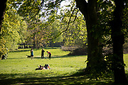 People out exercising responsibly and applying social distancing in Highbury Park as Coronavirus is felt on a local level on 25th April 2020 in Birmingham, England, United Kingdom. People here, in what is normally a quiet urban park are using the space more with those out exercising are doing so with care. Coronavirus or Covid-19 is a new respiratory illness that has not previously been seen in humans. While much or Europe has been placed into lockdown, the UK government has extended stringent rules as part of their long term strategy, and in particular social distancing.