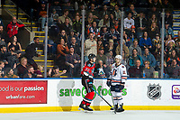 KELOWNA, BC - NOVEMBER 16: Dillon Hamaliuk #22 of the Kelowna Rockets gets up after a check into the boards by Max Martin #10 of the Kamloops Blazers as fans call for a penalty at Prospera Place on November 16, 2019 in Kelowna, Canada. (Photo by Marissa Baecker/Shoot the Breeze)