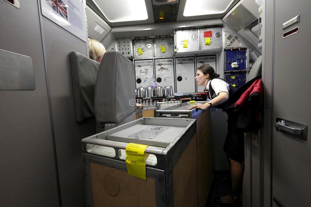 British airway stewardess at work in the airplanes kitchen