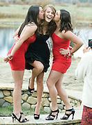 From left, Brooke Rice, Maryelizabeth Pistono and Jesse Mayers pose for Patricia Pistono's camera before Jackson Hole High School's prom begins.