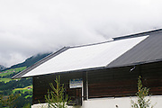 Solar Panels on a Farmhouse photographed in Untersulzbach Valley the Hohe Tauern National Park, Salzburg, Austria