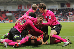 Harry Beautyman of Peterborough United (centre) celebrates after team-mate Ricardo Almeida Santos (floored) had scored the winning goal - Mandatory byline: Joe Dent/JMP - 19/03/2016 - FOOTBALL - The Keepmoat Stadium - Doncaster, England - Doncaster Rovers v Peterborough United - Sky Bet League One