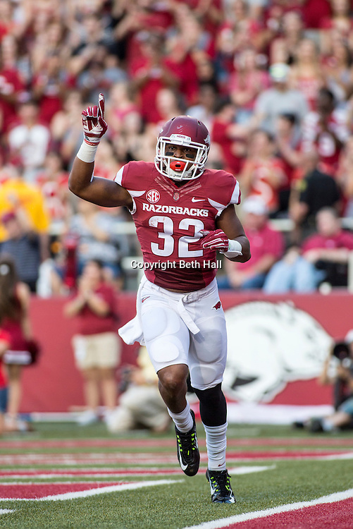 Sep 20, 2014; Fayetteville, AR, USA; Arkansas Razorbacks running back Jonathan Williams (32) reacts to a scoring a touchdown during the first half of a game against the Northern Illinois University Huskies at Donald W. Reynolds Razorback Stadium. Arkansas defeated NIU 52-14. Mandatory Credit: Beth Hall-USA TODAY Sports