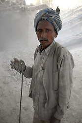Chitrakoot District, Uttar Pradesh, India: A portrait of a stone worker int the Chitrakoot District of Uttar Pradesh, India.  (Photo by Ami Vitale)