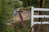 September 13, 2013: A small creek that flows under Alkire Street in Arvada, CO turns unto a fast moving river and overflows its banks into neighboring yards after record breaking rains hit Colorado over the last few days