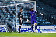 Crewe Alexandra goalkeeper Dave Richards (13) argues with Referee Alan Young about penalty decision during the EFL Sky Bet League 1 match between Gillingham and Crewe Alexandra at the MEMS Priestfield Stadium, Gillingham, England on 26 January 2021.