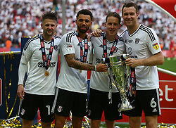 May 26, 2018 - London, England, United Kingdom - L-R Fulham's Tom Cairney, Fulham's Ryan Fredericks, Fulham's Stefan Johansen and Fulham's Kevin McDonald   with Trophy.during the Championship Play-Off Final match between Fulham and Aston Villa at Wembley, London, England on 26 May 2018. (Credit Image: © Kieran Galvin/NurPhoto via ZUMA Press)