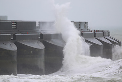 © Licensed to London News Pictures. 02/06/2015. Brighton, UK. Waves hitting the sea wall at Brighton Marina. Brighton and the South Coast are being battered by strong wind and big waves. The Lifeguard Service has raised the red flag advising people to stay out the water. today June 2nd 2015. Photo credit : Hugo Michiels/LNP