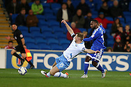 Junior Hoilett of Cardiff city ® has a shot at goal as Tom Lees of Sheffield Wednesday blocks.  .EFL Skybet championship match, Cardiff city v Sheffield Wednesday at the Cardiff city stadium in Cardiff, South Wales on Wednesday 19th October 2016.<br /> pic by Andrew Orchard, Andrew Orchard sports photography.