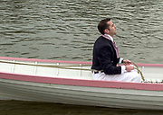 Putney. London.  2004 University Boat Race,  Championships Course, Putney to Mortlake. <br /> Re enactment row Boat Race. CUBC Cox.  Cambridge and Oxford . CUBC Boarding to complete [Mandatory Credit Peter SPURRIER]