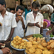 A road-side stall selling vada pao and other snacks, Mumbai, June 2007