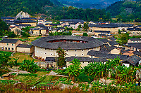 """Chine, Province du Fujian, village de Hekeng, maison forteresse en terre et en bois où logent les membres d'une meme famille de l'ethnie Hakka, inscrit au patrimoine mondial de l'Unesco // China, Fujian province, Hekeng village, Tulou mud house. well known as the Hakka Tulou region, in Fujian. In 2008, UNESCO granted the Tulou """"Apartments"""" World Heritage Status, siting the buildings as exceptional examples of a building tradition and function exemplifying a particular type of communal living and defensive organization. The Fujian Tulou is """"the most extraordinary type of Chinese rural dwellings"""" of the Hakka minority group and other people in the mountainous areas in southwestern Fujian."""