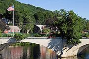 An American flag glies over the Bridge of Flowers in Shelburne Falls, Massachusetts.