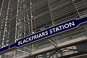 Entrance of the newly-finished Blackfriars mainline Station in the City of London. A larger and more accessible Blackfriars Underground station reopened for public service to accommodate more than 40,000 passengers every day. Blackfriars station was opened as St Paul's by the London Chatham and Dover Railway (LC&DR) in May 1886. St Paul's station was renamed Blackfriars on 1 February 1937 and is now a central London railway terminus and London Underground complex in the City of London. Its platforms span the River Thames a short distance downstream from Blackfriars Bridge.