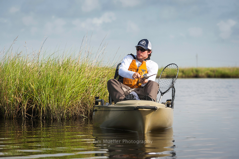 Stephen Lutz casts for redfish at the Pointe-aux-Chenes Wildlife Management Area. The wildlife management area is located in Terrebonne and Lafourche Parishes, approximately 15 miles southeast of Houma. This area, which is owned by the Louisiana Department of Wildlife and Fisheries, includes about 35,000 acres of wetlands and marsh.