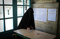 A voter fills in her ballot at a polling station in the city of Qom, Iran, on Feb. 26, 2016. Elections for Iran's parliament (Majlis) and Assembly of Experts kicked off at 8 a.m. local time (0430 GMT) on Friday. EXPA Pictures © 2016, PhotoCredit: EXPA/ Photoshot/ Ahmad Halabisaz<br /><br />*****ATTENTION - for AUT, SLO, CRO, SRB, BIH, MAZ only*****