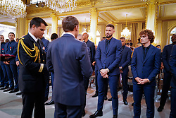 French president Emmanuel Macron awards Olivier Giroud during a Legion of Honour award ceremony for French 2018 football World Cup winners at the Elysee Palace in Paris, on June 4, 2019. Photo by Hamilton/pool/ABACAPRESS.COM