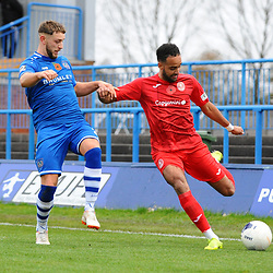 TELFORD COPYRIGHT MIKE SHERIDAN Brendon Daniels of Telford crosses under pressure from James Baillie during the Vanarama National League Conference North fixture between Curzon Asthon and AFC Telford United on Saturday, November 9, 2019.<br /> <br /> Picture credit: Mike Sheridan/Ultrapress<br /> <br /> MS201920-028