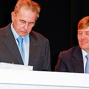 NLD/Arnhem/20121103 - 100 Jarig bestaan NOC/NSF Sportparade,  Jaques Rogge en Prins Willem- Alexander signeren het boek
