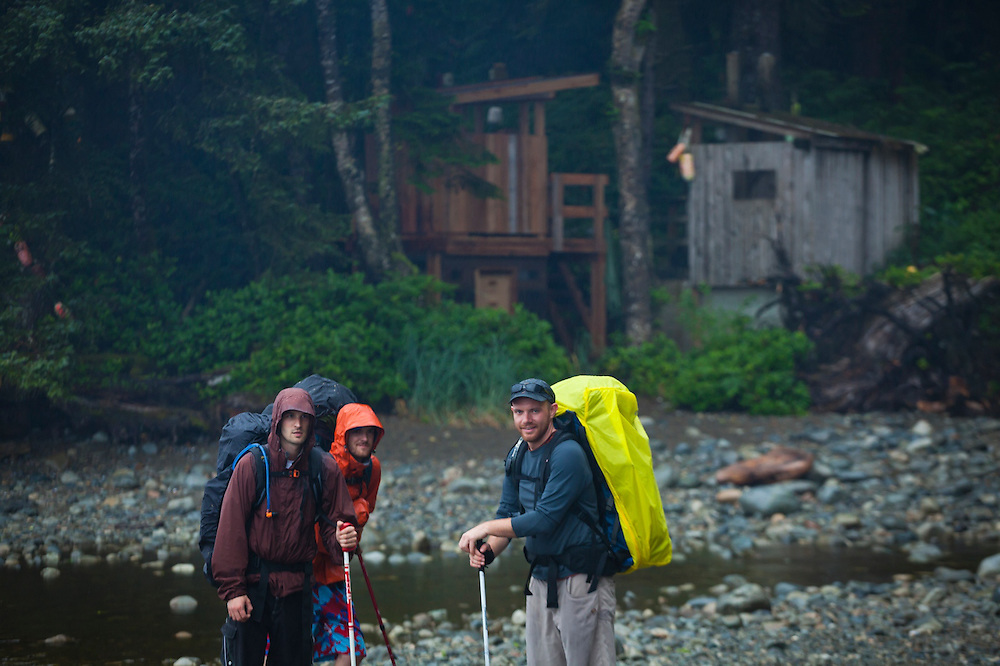 A group of hikers at Michigan Creek, West Coast Trail, British Columbia, Canada.
