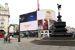 © Licensed to London News Pictures. 08/05/2020. London, UK. People observe a two minutes silence  in Piccadilly Circus on the 75th anniversary of the end of World War II in Europe. The anniversary also coincides with the current Covid-19 outbreak lockdown. Photo credit: London News Pictures