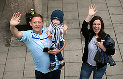 Coventry City fans wave during the Sky Bet League Two promotion parade in Coventry.