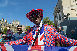 A man in a union flag suit poses for photographs as excitement builds up in Windsor ahead of the royal wedding on Saturday 19th May when HRH Prince Harry weds actress Megan Markle. Windsor, May 17 2018.