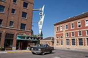 Pick up turns a corner at an Art Deco sign for the Murray Hotel and Cafe in Livingstone, Montana.