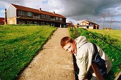 Boy playing on Bradford Housing estate
