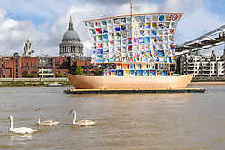"""© Licensed to London News Pictures. 04/09/2019. LONDON, UK. A swan and cygnets pass by during the photocall for the launch of """"The Ship of Tolerance"""" at Tate Modern, Bankside.  The floating installation by Emilia Kabakov (of Russian conceptual artist duo Ilya and Emilia Kabakov) forms part of Totally Thames Festival and will be moored 4 September to 31 October.  The goal of the artwork is to educate and connect the youth of the world through the language of art.  Photo credit: Stephen Chung/LNP"""