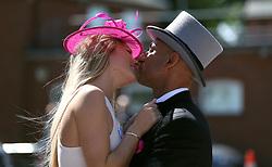 Racegoers enjoy a kiss during day three of Royal Ascot at Ascot Racecourse.