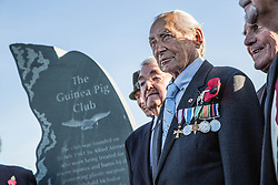 """Surviving member of the RAF's """"Guinea pig club"""" Jan Stanrycruk stands with other survivors next to their newly unveiled memorial that was unveiled by The Duke of Edinburgh, President, the Guinea Pig Club at the National Memorial Arboretum, Staffordshire."""