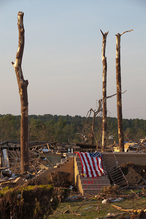 An American Flag in Front of the remain of a home in Smithville, A suburb of Tuscaloosa remains in a state of ruin over two weeks after it was hit by an F-4 ( possibly an F-5) tornado, one of an estimated 300 that struck Alabama and the neighboring states on April 27th , 2011.